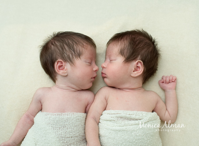 Twin Newborn Session Babies Looking at Each Other Photo